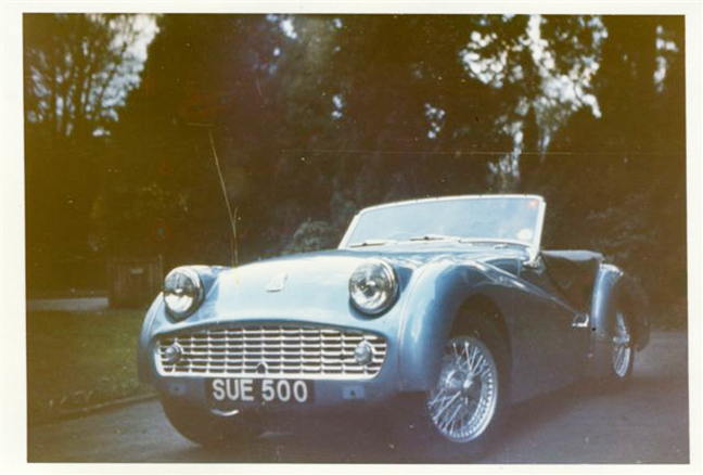 Photo of a blue TR3 car with registration plate SUE 500